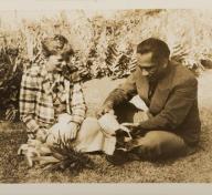 Duke Kahanamoku cuts a pineapple with Amelia Earhart, United States, Hawaiʻi, Oʻahu, Honolulu, January 11,1935