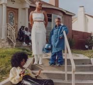 Photo of family on steps in front of house
