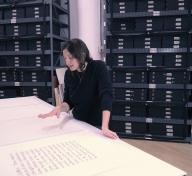 Analia Saban viewing the Sol LeWitt and Frederick Hammersley works she selected