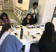 The 2019 Mellon Summer Academy students: Jenebrith Pastran, Emily Le, JaBrea Patterson-West (advisor), Melissa San Miguel, Victoria Vargas, and Eavan McNeil discussing their selected photographs