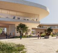 Exterior view of museum building with people enjoying the p