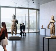 Visitors in an airy gallery with sculptures