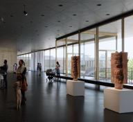 Gallery view with artworks and people